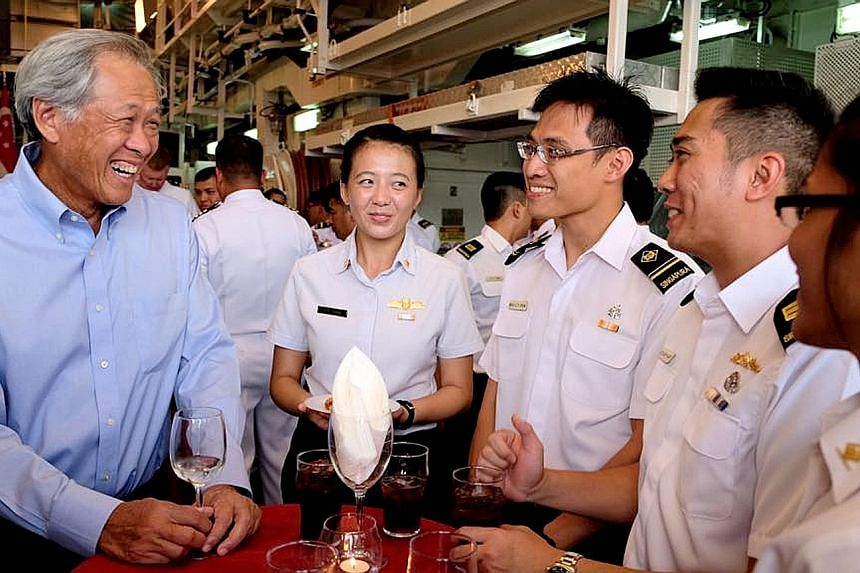 Defence Minister Ng Eng Hen interacting with personnel from the Republic of Singapore Navy who are participating in Exercise Rimpac. The biennial warfare exercise - from June 28 to Aug 3 - involves 25,000 personnel, 45 ships, five submarines and abou