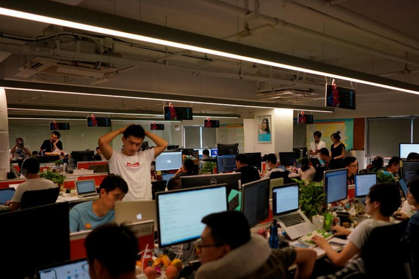 Employees work at the DingTalk office, an offshoot of Alibaba Group Holding Ltd, in Hangzhou, Zhejiang province, China, on July 20, 2018.