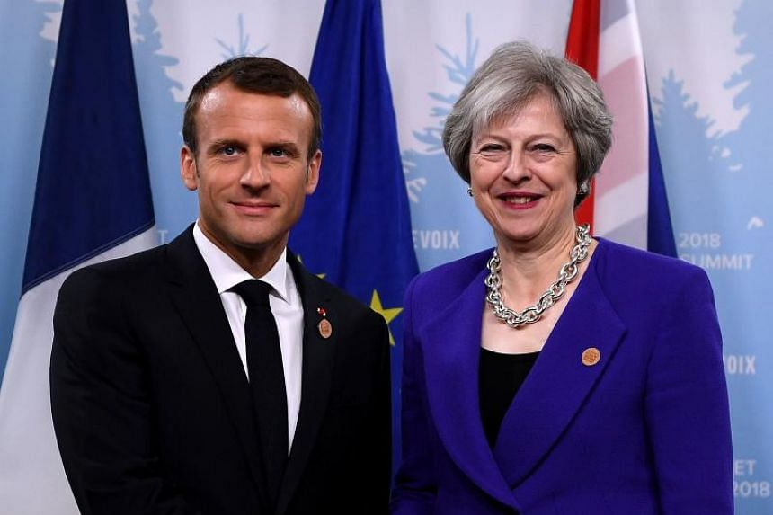"""British Prime Minister Theresa May (right) and French President Emmanuel Macron will hold an """"informal"""" two-hour meeting at Bregancon, a 17th-century fort long favoured by French presidents as a summer retreat."""