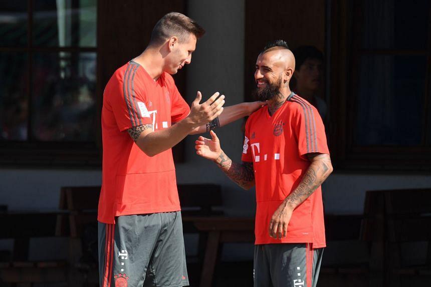 Bayern Munich's Niklas Suele (left) greeting Arturo Vidal prior to a team training session on Aug 3, 2018.