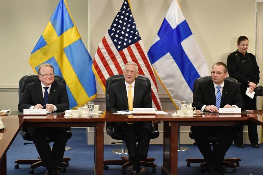 US Defence Secretary Jim Mattis (centre) takes part in a trilateral meeting with Swedish Defence Minister Peter Hultqvist (left) and Finnish Defence Minister Jussi Niinisto  at the Pentagon in Washington, DC, on May 8, 2018.