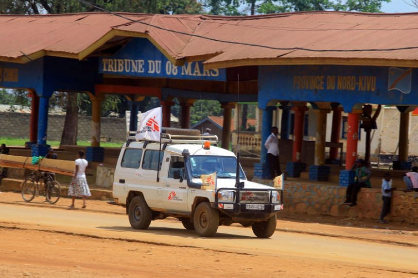 An ambulance from the Medecins Sans Frontieres (MSF) drives through a street in the town of Beni in North Kivu province of the Democratic Republic of Congo, on Aug 2, 2018.