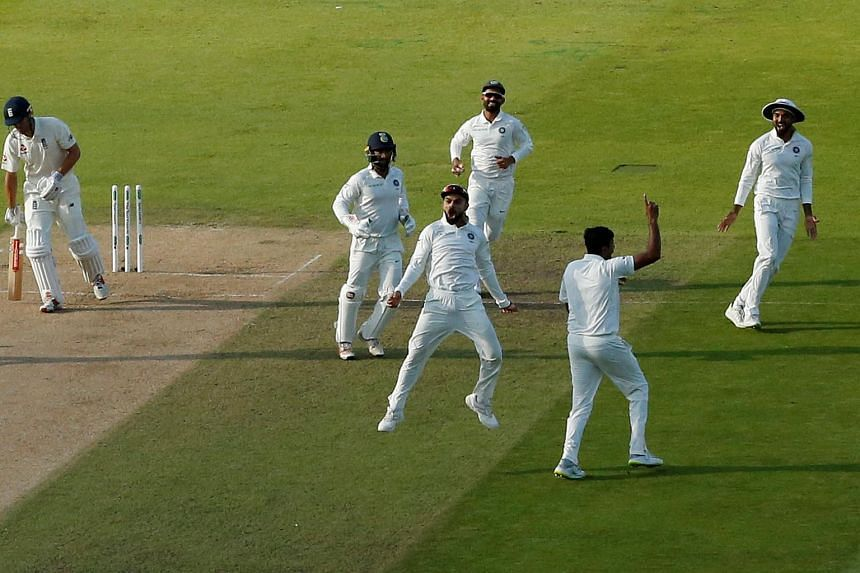 India's Virat Kohli celebrating after England's Alastair Cook was bowled out during the 1st Test cricket match between England and India.