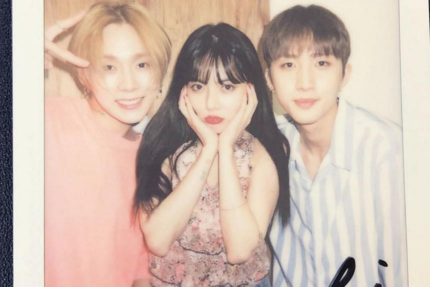 HyunA (centre) confirmed that she was dating Cube Entertainment colleague and fellow Triple H bandmate E'Dawn (left) on Aug 3.