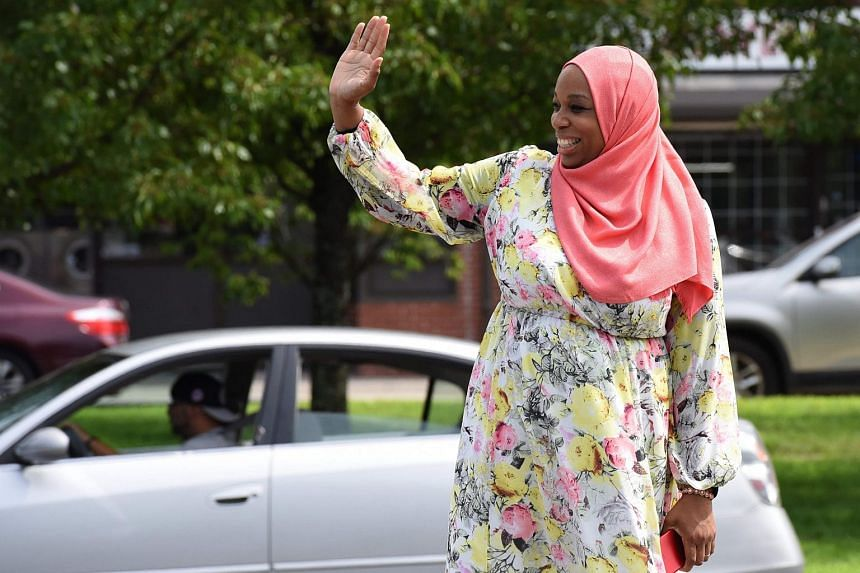 Tahirah Amatul-Wadud goes on a door-knocking and voter registration drive in Chicopee, Massachusetts, on July 21, 2018.