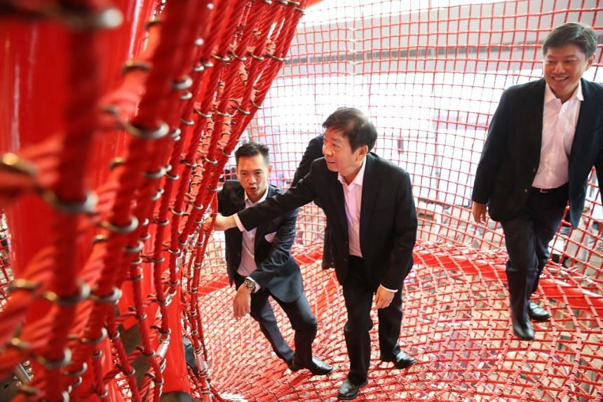 Minister Khaw Boon Wan (centre) and Mr Ng Chee Meng exploring the playground in Terminal 4.