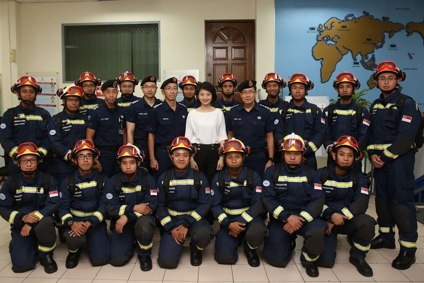 Ms Sun Xueling (centre) and the SCDF Commissioner with the SCDF Contingent.
