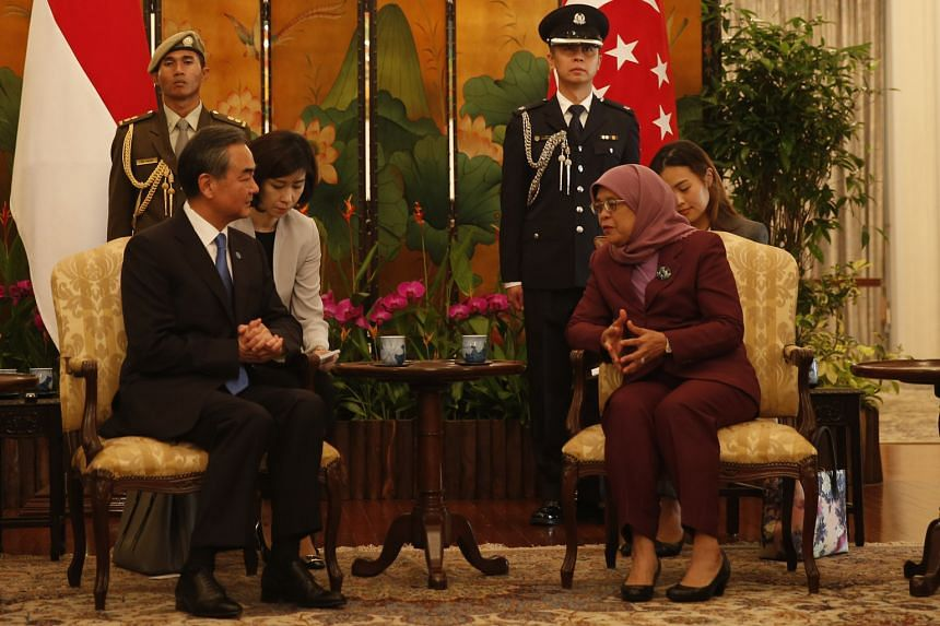China's Foreign Minister Wang Yi calling on President Halimah Yacob at the Istana yesterday. Mr Wang welcomed the progress on the Code of Conduct, calling it a major development.