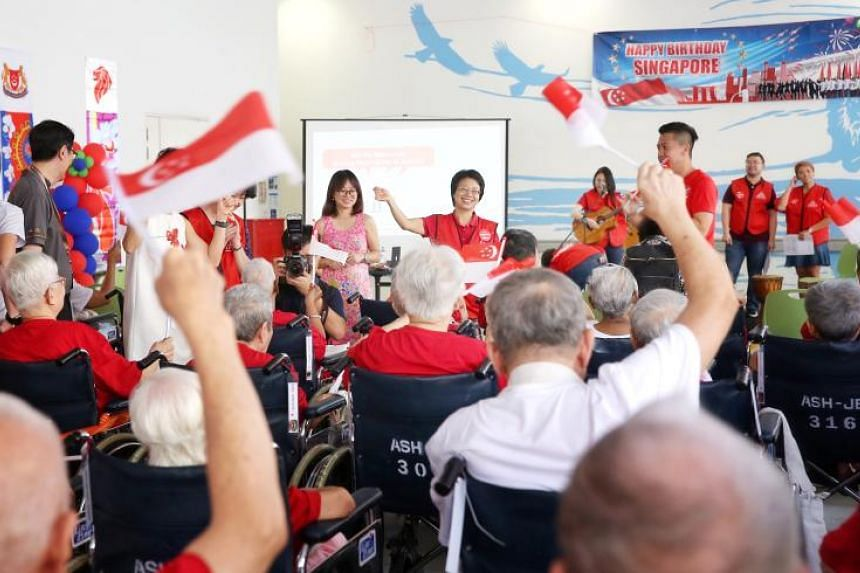 The seniors from All Saints Home in Jurong East sang National Day songs, belted out classic Malay and Chinese tunes, and ate traditional snacks during the mini carnival brought to their door step.