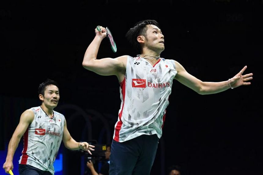 Japan's Takeshi Kamura (right) and Keigo Sonoda hit a shot against Indonesia's Marcus Fernaldi Gideon and Kevin Sanjaya Sukamuljo during their men's doubles match during the badminton World Championships in Nanjing, China, on Aug 3, 2018.