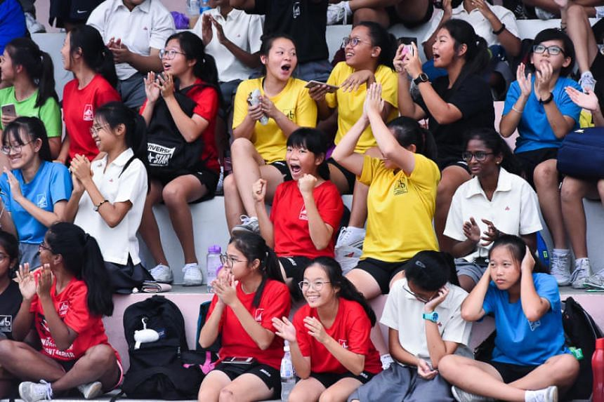 Supporters from Bukit Batok Secondary School cheer the team on in the second-tier Schools National C Division Rugby Championship (Bowl) on Aug 1, 2018.