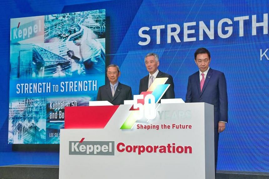 (From left) Dr Lee Boon Yang, chairman of Keppel Corporation, Prime Minister Lee Hsien Loong and CEO of Keppel Corporation Loh Chin Hua launch Keppel Corporation's 50th anniversary commemorative book on Aug 3, 2018.