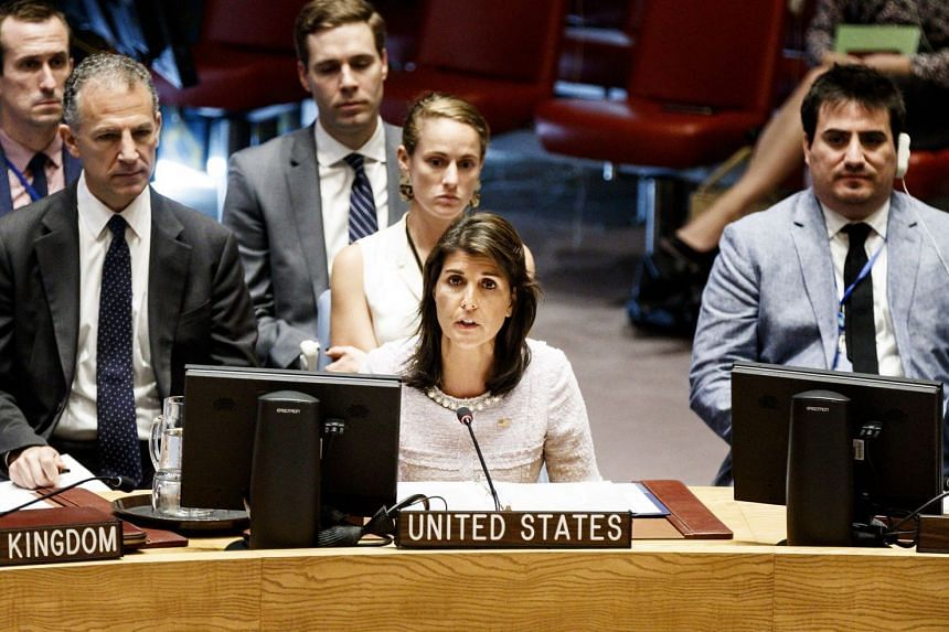 """Nikki Haley (above, centre) said the """"credible"""" reports of Russia violating UN sanctions were """"deeply troubling""""."""