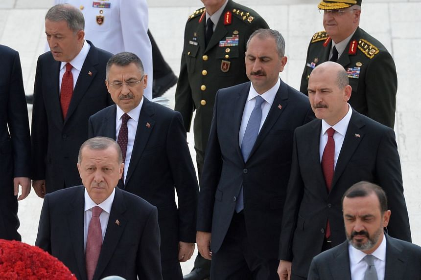 Erdogan (front, left), Soylu (back, right) and Gul (back, second-right) join other Cabinet ministers for a ceremony in Ankara.