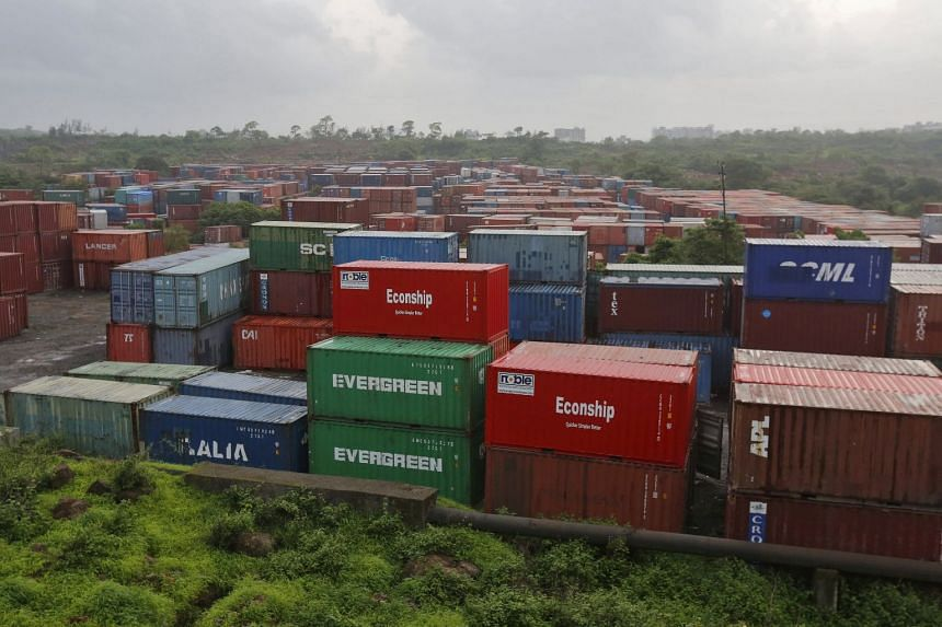 File photo showing cargo containers in India, where new higher tariffs against some goods imported from the United States will go into force on Sept 18, 2018.