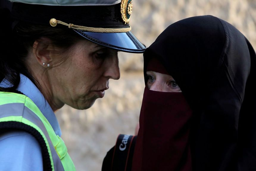 A police officer speaks with a woman during a protest against the ban on Aug 1, 2018.