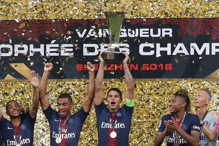 Paris St Germain's Thiago Silva celebrates with the trophy and team mates after winning the French Super Cup.