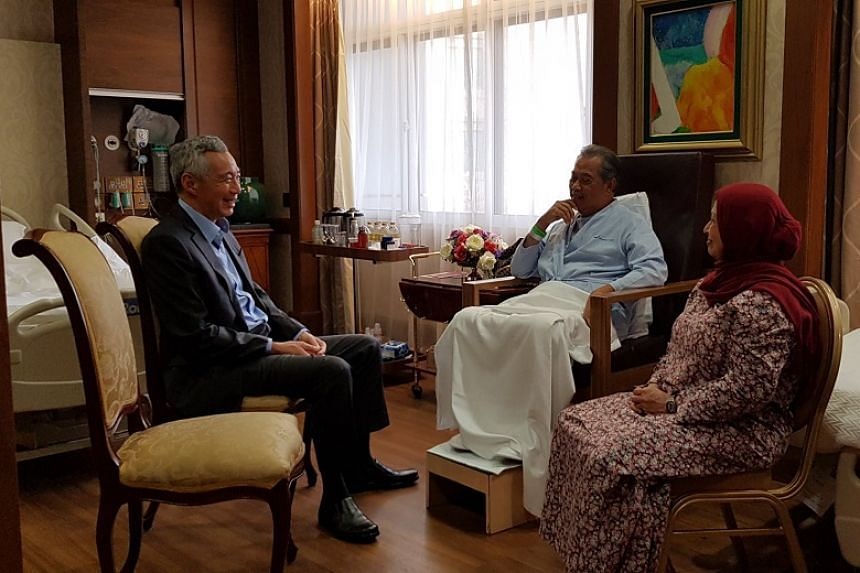 PM Lee (left) said he was glad the treatment went well and wished Malaysian Home Minister Muhyiddin Yassin (centre) a speedy recovery.