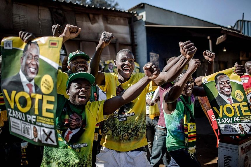 Supporters celebrating yesterday in the suburb of Mbare of Zimbabwe's capital Harare after President Emmerson Mnangagwa is declared the winner in the country's landmark election with 50.8 per cent of the vote. His main rival Nelson Chamisa won 44.3 p