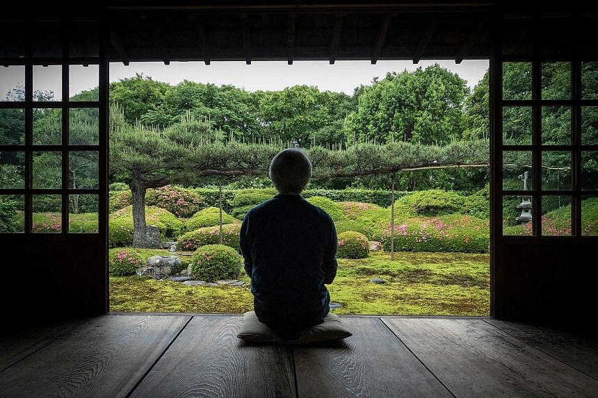 Japanese gardener Chisao Shigemori sits in front of a garden covered with different types of moss in Kyoto. A Japanese woman admires moss (above) on a viewing tour at the Yatsugatake forest; and moss seller Oichi Kiyomura with baskets of collected mo