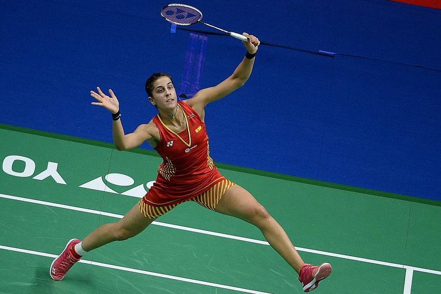 Spain's Carolina Marin making a return to India's Saina Nehwal in the women's singles quarter-finals at the World Championships in Nanjing, China, yesterday. The 25-year-old Spaniard trounced Nehwal 21-6, 21-11.