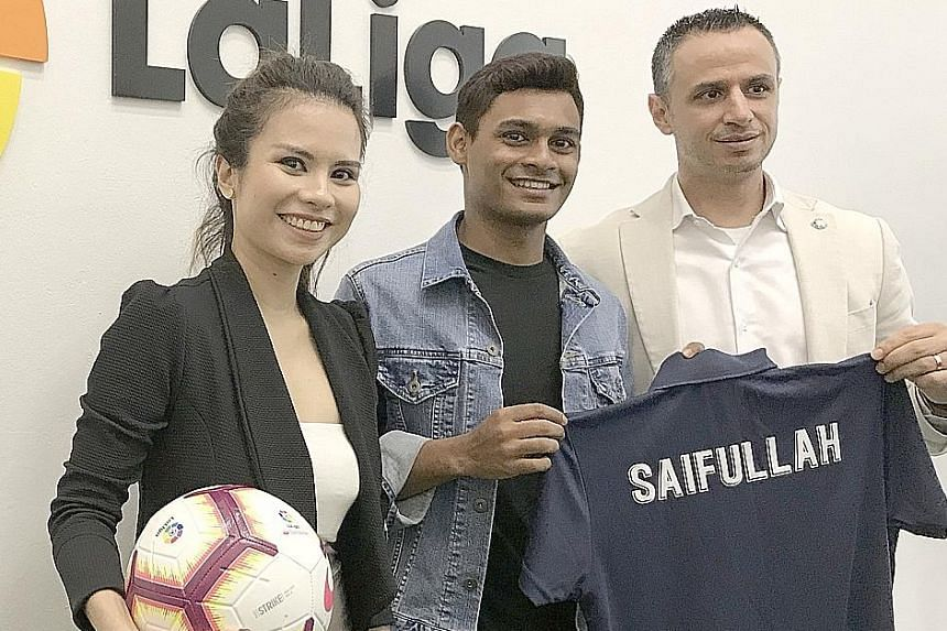 Singapore footballer Saifullah Akbar, 19, with his agent Ash Hashim and LaLiga Singapore office managing director Ivan Codina. The attacking midfielder leaves on Tuesday for a 10-day trial with Spanish club Tenerife.
