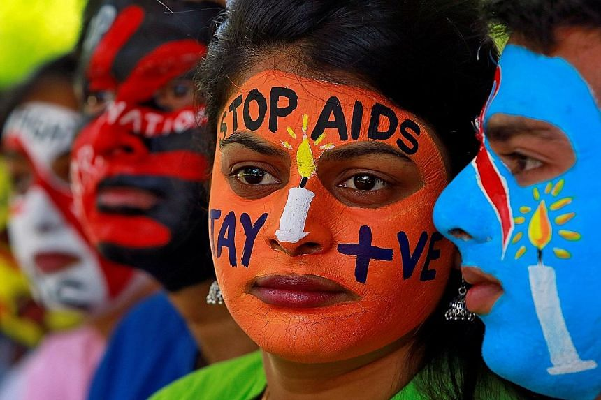 Students with their faces painted with messages during an HIV/Aids awareness campaign to mark the International Aids Candlelight Memorial in the Indian city of Chandigarh in May. India wants to reduce new HIV infections by 75 per cent between 2010 an