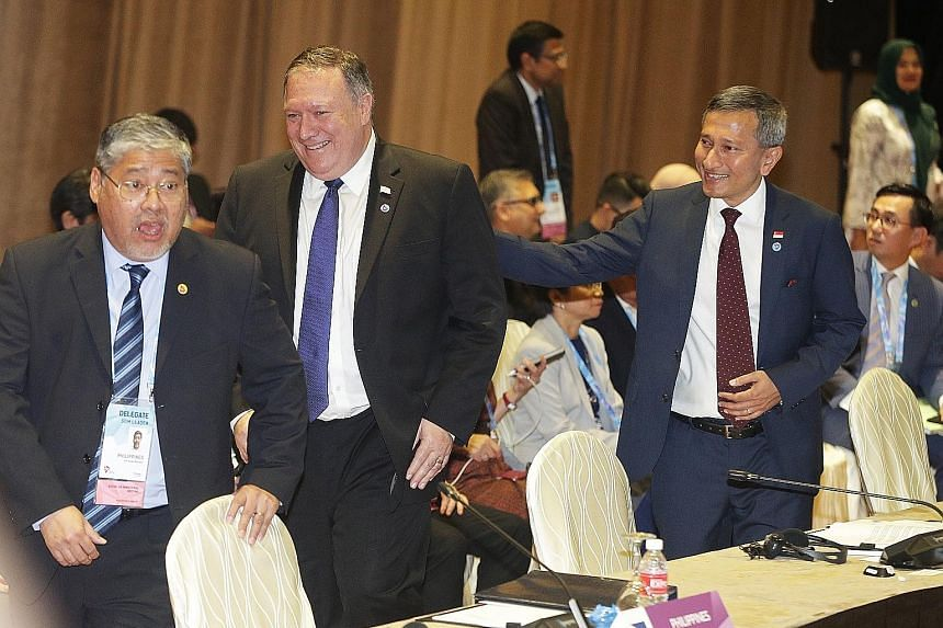 From right: Foreign Minister Vivian Balakrishnan, US Secretary of State Mike Pompeo and Philippine Foreign Affairs Undersecretary Enrique Manalo at the Asean-US Ministerial Meeting yesterday. Mr Pompeo underlined his country's continued commitment to