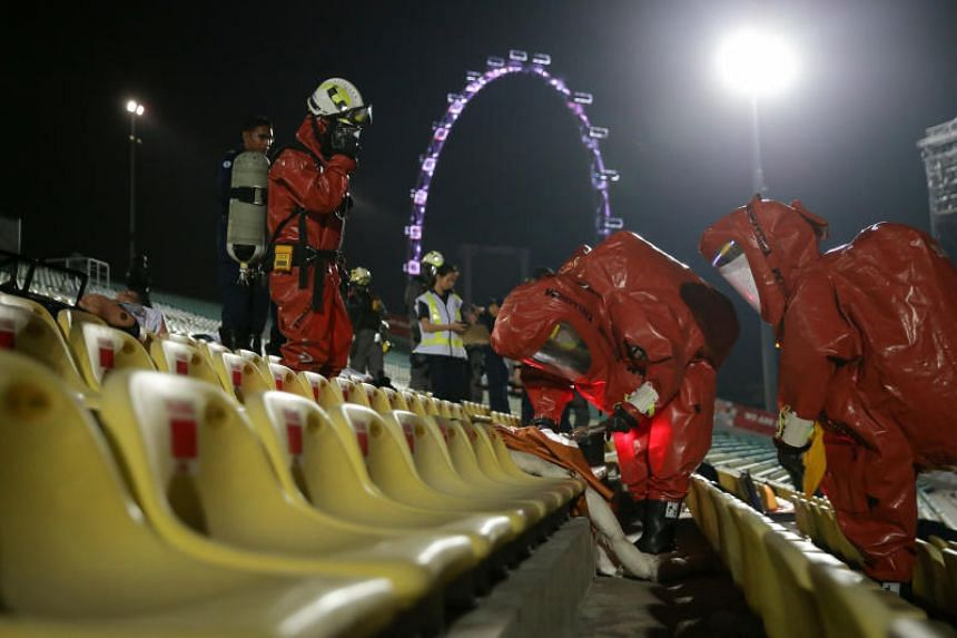 """Singapore Civil Defence Force officers at the Marina Bay Floating Platform during a mock """"chemical attack""""."""