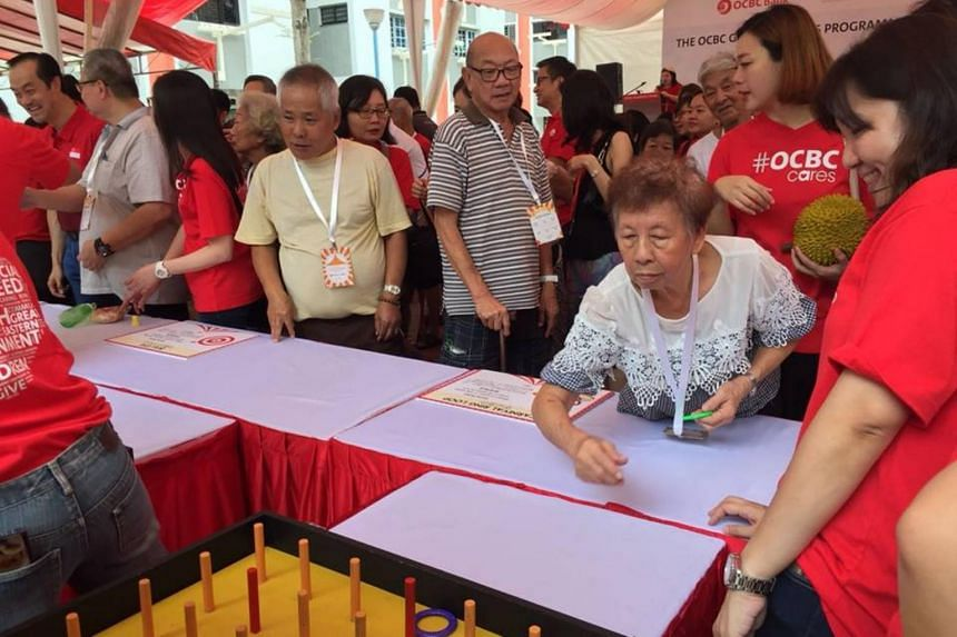 A pilot programme funded by OCBC bank aims to tackle the scourge of dementia among the elderly by trying to motivate those vulnerable to take part in activities that would improve their motor and cognitive skills.