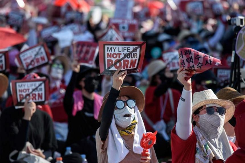 Female protesters shout slogans during a rally against 'spy-cam porn' in central Seoul on Aug 4, 2018.