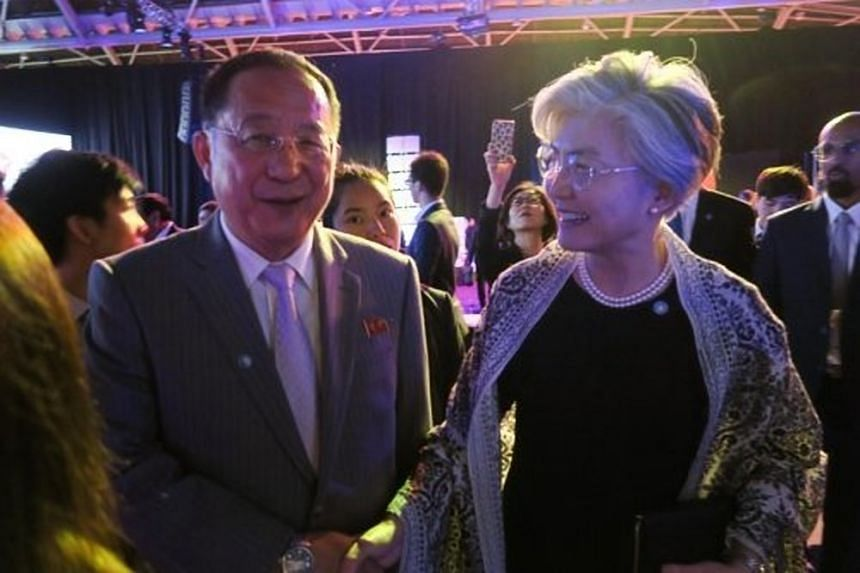 North Korean Foreign Minister Ri Yong Ho (left) with his South Korean counterpart Kang Kyung-wha on the sidelines of the Asean gala dinner in Singapore.