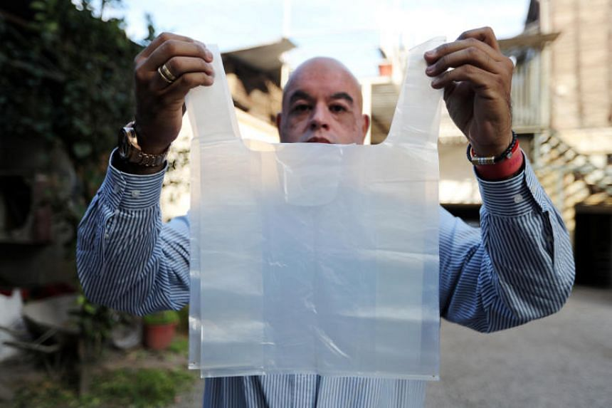 Chilean engineer Roberto Astete holds up a water-soluble bag that could replace traditional plastic bags without causing damage to the environment or the liquid that absorbs them, in Santiago, Chile, on July 26, 2018.