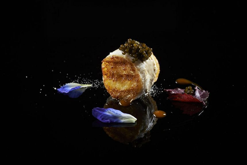 The Cristal de Chine Caviar is a toasted sandwich with a slab of kaya ice cream in the middle and topped with caviar in place of salted butter.