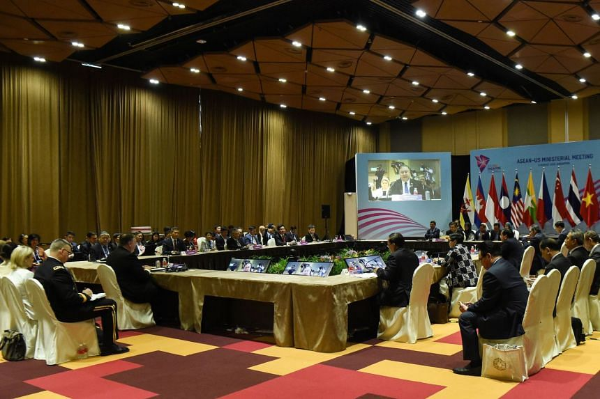 US Secretary of State Mike Pompeo (left, at table) delivers his opening remarks at the Asean - US Ministerial Meeting in Singapore, on Aug 3, 2018.