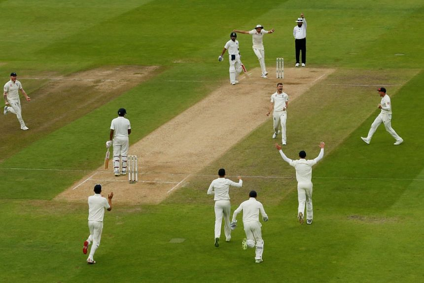 England's James Anderson celebrates taking the wicket of India's Ravi Ashwin.