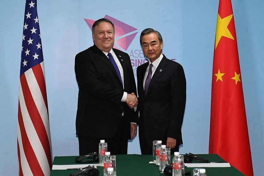 US Secretary of State Mike Pompeo (left) and China's Foreign Minister Wang Yi (right) shake hands during their bilateral meeting at the 51st Association of Southeast Asian Nations (Asean) in Singapore on Aug 3, 2018.