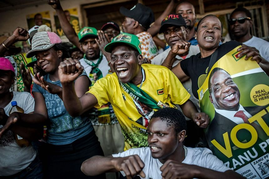 Mnangagwa supporters celebrate in Mbare, a district of the Zimbabwe's capital Harare.