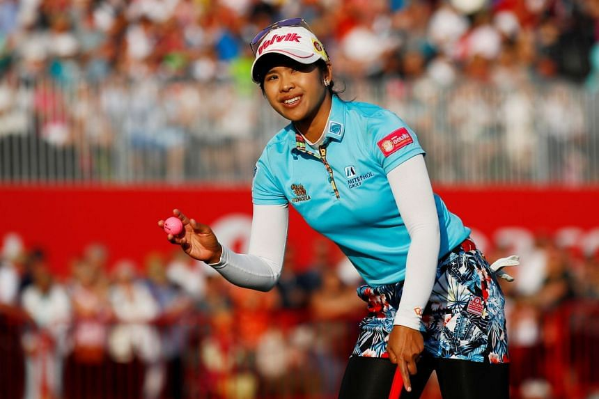 Thailand's Pornanong Phatlum reacts on the 18th green during the third round.