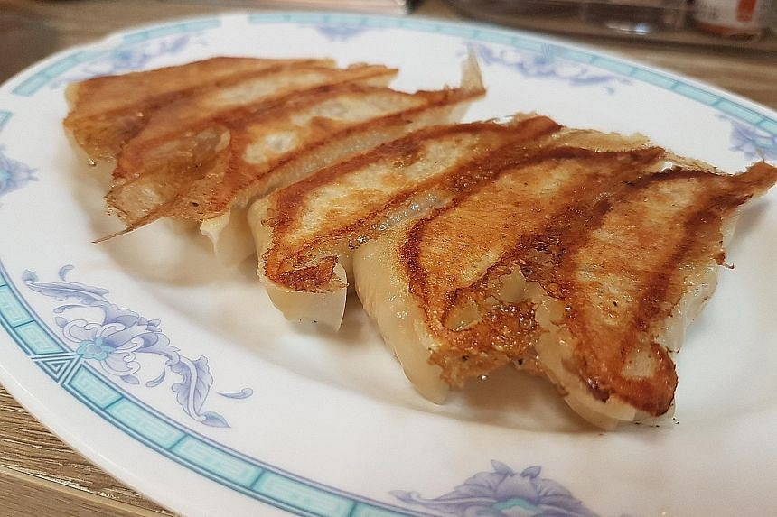 Grandma's Fish Maw Soup features a handmade fishcake rolled into a rosette. These pot stickers taste good even when they are cold.