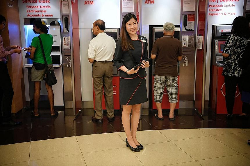 OCBC's Miss Aisha Poh Zi Qian was unfazed by the bank's plan to halve the number of its bank teller jobs over two years. In March, she was among the first batch of 16 to be retrained as digital ambassadors.