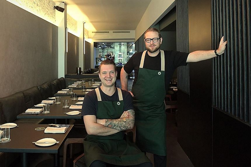 Australian chef Clayton Wells (standing)in his restaurant Blackwattle in Amoy Street, which was helmed byDutch head chef Joeri Timmermans (seated).