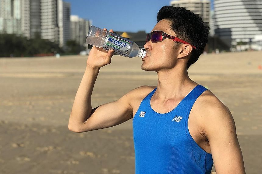 Mok Ying Ren hydrating himself with the non-carbonated 100Plus Active, his preferred choice for training and races. 100Plus is the official hydration partner for the Sept 23 ST Run.