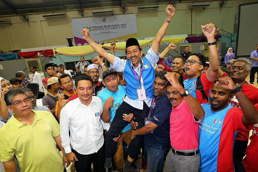 Victorious PH candidate Mohd Zawawi Ahmad Mughni with his supporters in Selangor's capital Shah Alam yesterday.
