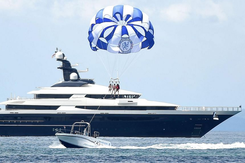 The luxury yacht Equanimity (left) was allegedly purchased with funds embezzled from scandal-ridden 1MDB. The vessel is allegedly owned by fugitive financier Jho Low.