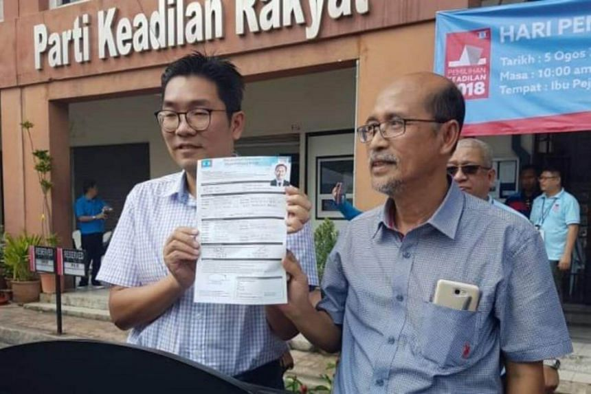 The nomination papers were filed by Parti Keadilan Rakyat strategic director Sim Tze Tzin (left) on behalf of Anwar Ibrahim at 11.15am on Aug 5, 2018, at the party's headquarters.