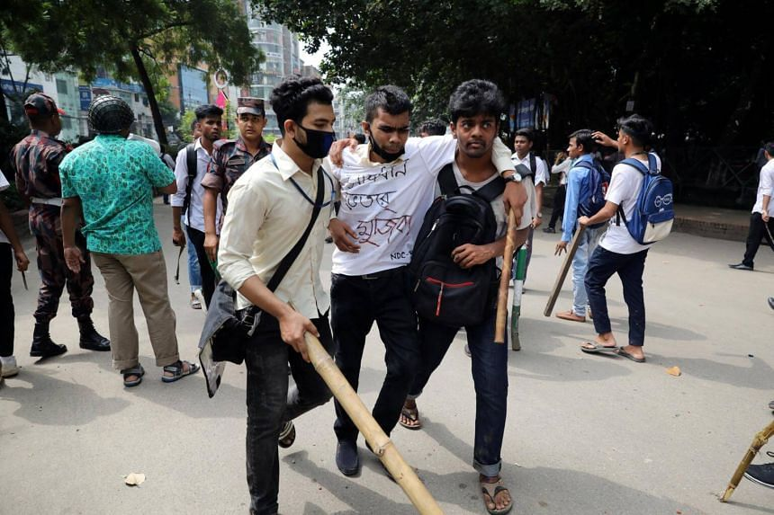 An injured student being helped during clashes with unidentified miscreants while protesting over recent traffic accidents that killed a boy and a girl, in Dhaka, Bangladesh, on Aug 4, 2018.