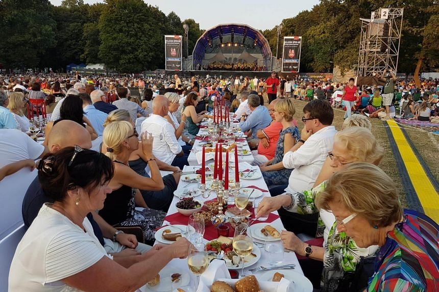 Some turn the concert at the park into a full dining experience. This is part of the group of 48 people who gather every year over the last decade to enjoy the music and atmosphere.