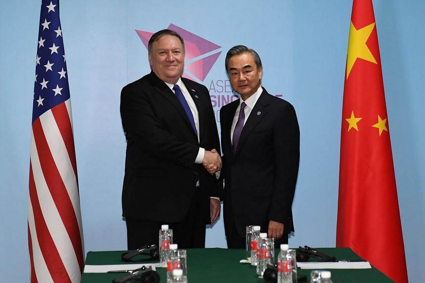 US Secretary of State Mike Pompeo and China's Foreign Minister Wang Yi shake hands before their bilateral meeting at the 51st Association of Southeast Asian Nations in Singapore, on Aug 3, 2018.