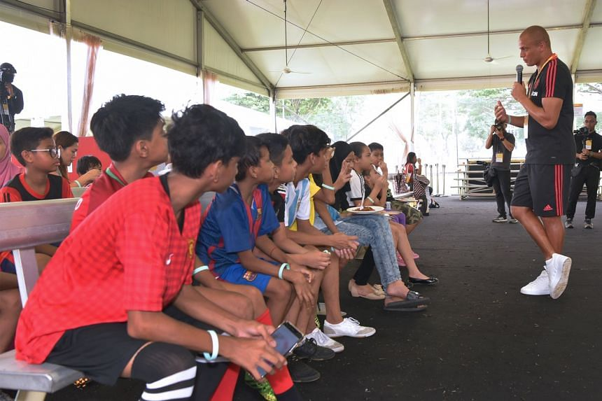 Former Manchester United player Wes Brown giving a motivational talk to The Straits Times School Pocket Money Fund beneficiaries.
